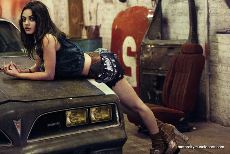 Mila-Kunis-Poses-Hood-1977-Pontiac-Trans
